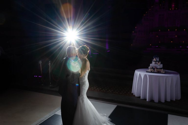 Bride & Groom enjoy their first dance with star burst lense flare