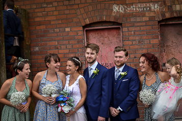 Group image of bridal party at Victoria Warehouse, everyone is laughing and relaxed
